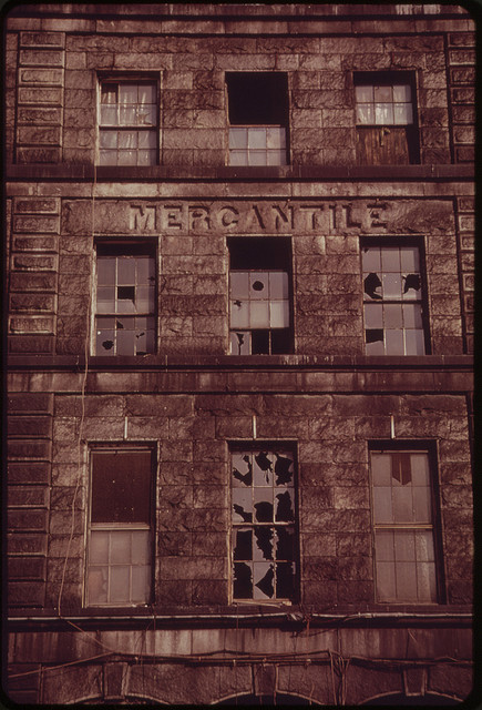 brick front of Boston mercantile building with broken windows
